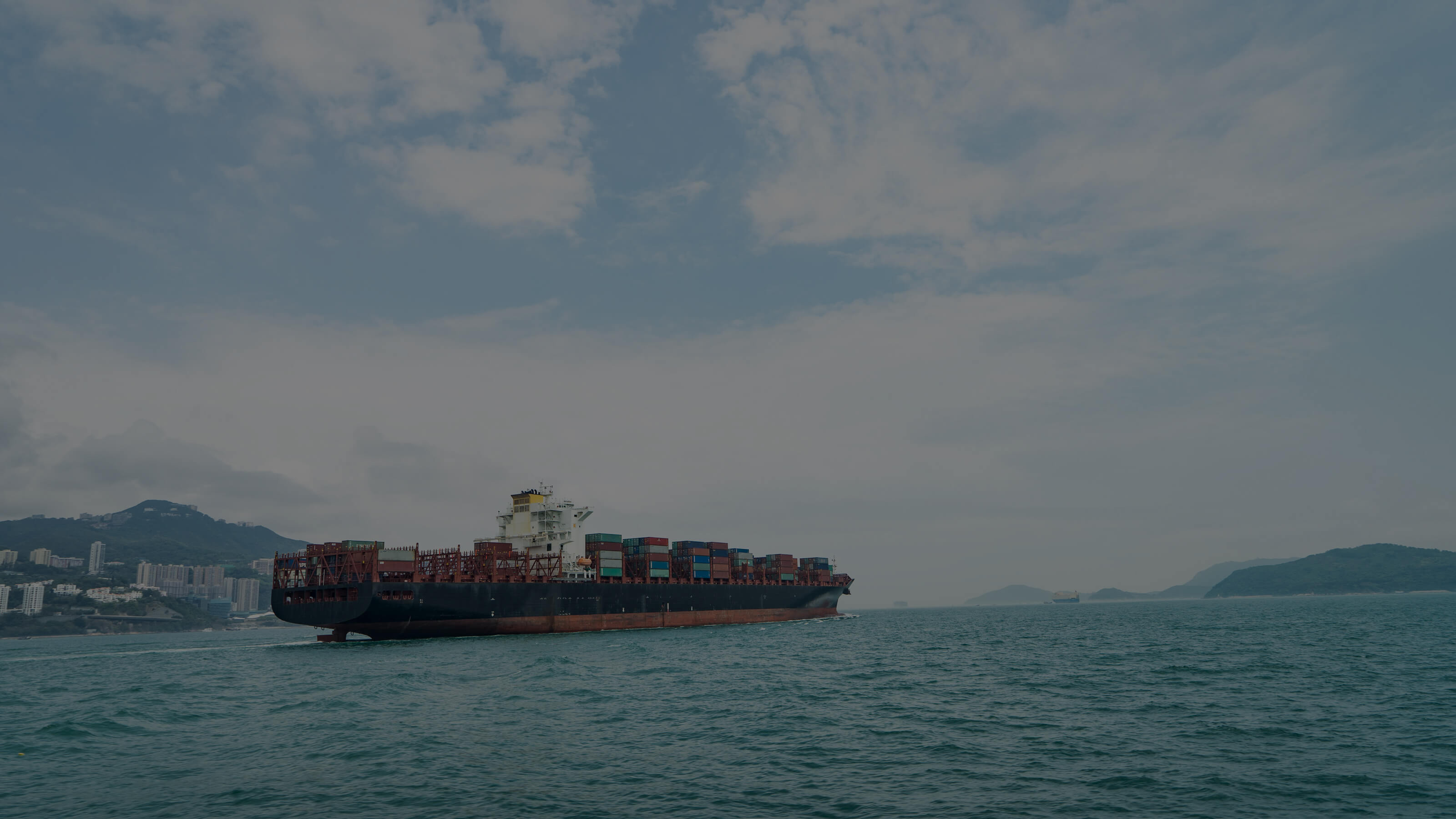 Ocean going container vessel leaving port.