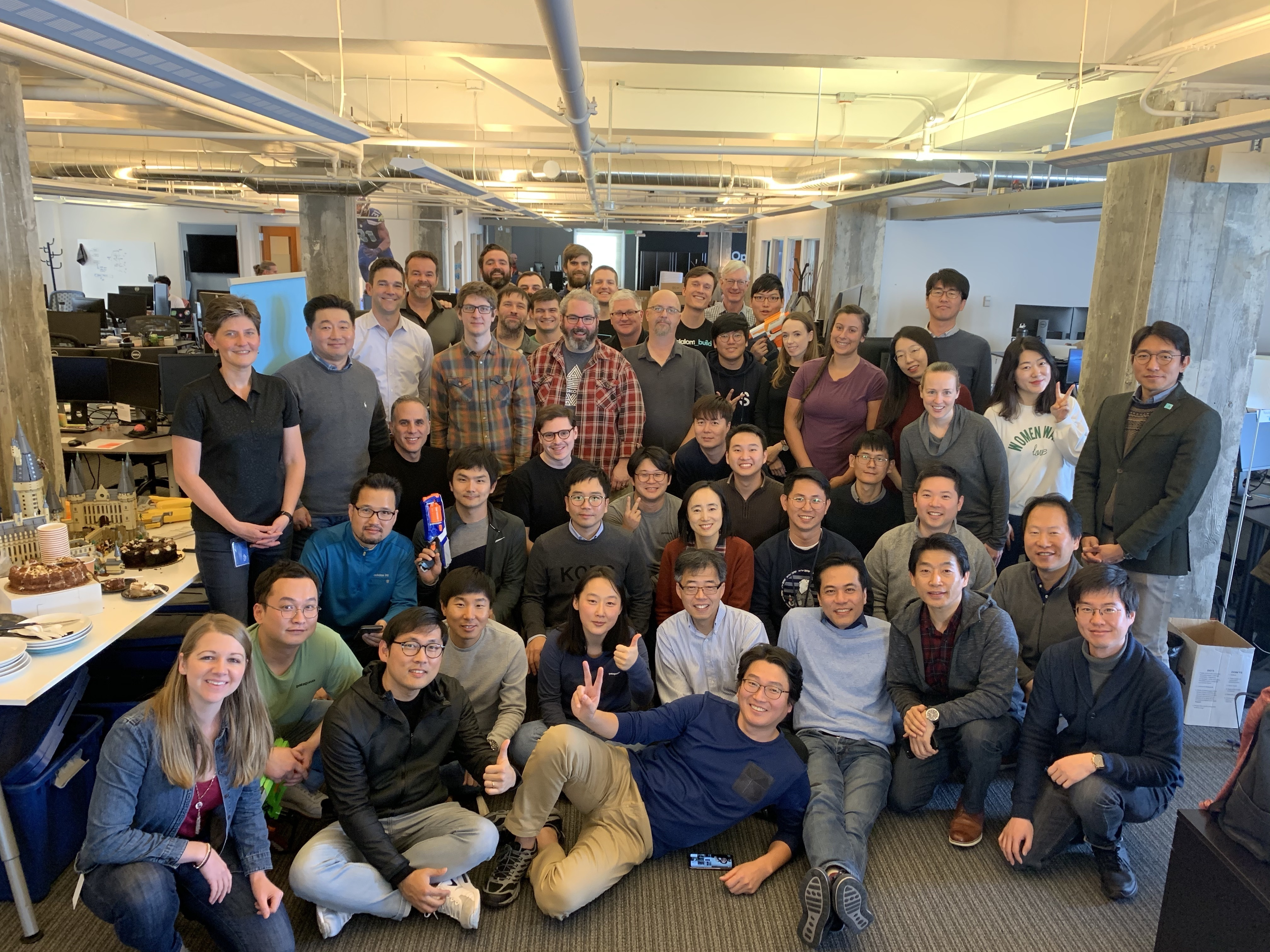 Large group of LG and Slalom Build builders together during an office event.